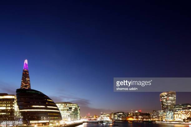 london city skyline across river thames at night - architecture stock pictures, royalty-free photos & images