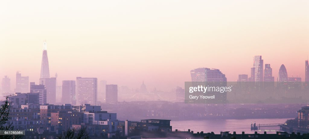 London city skyline and River Thames in the fog : Stock Photo