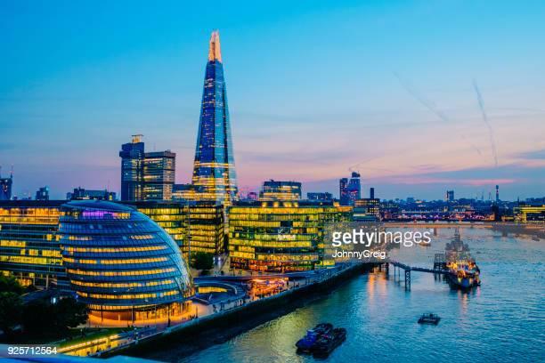 London city skyline illuminated at sunset