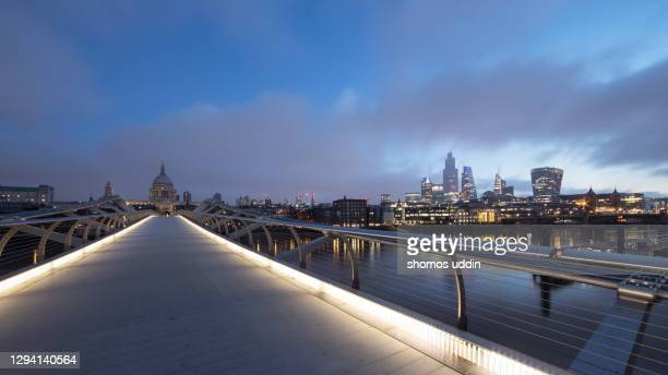 london city skyline illuminated at twilight with dramatic sky overhead - dramatic sky stock pictures, royalty-free photos & images