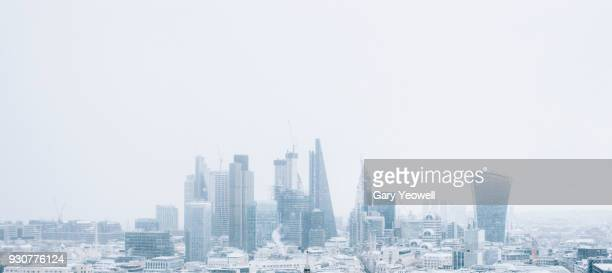 london city skyline in winter snow - frozen stock pictures, royalty-free photos & images