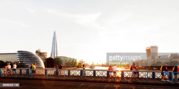London city skyline panorama at sunset with travellers and tourists in the foreground