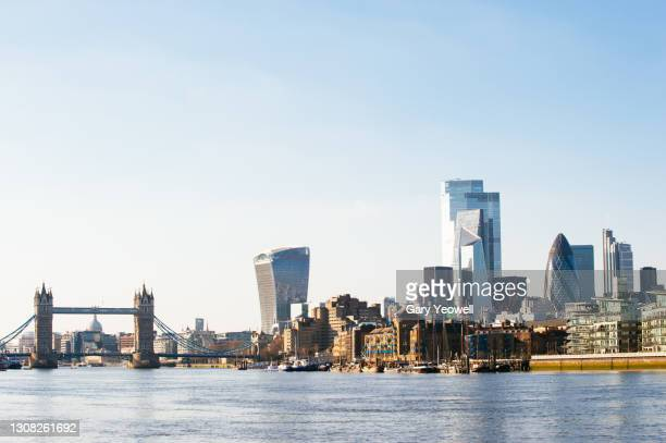 london city skyline with tower bridge and river thames - architecture stock pictures, royalty-free photos & images