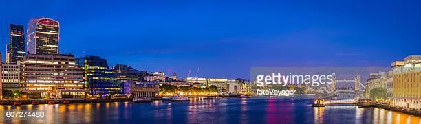 London City skyscrapers Tower Bridge Embankment lamplight reflecting Thames panorama