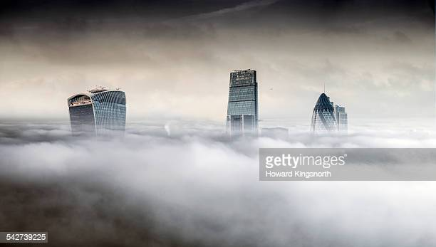 London city towers rising over fog