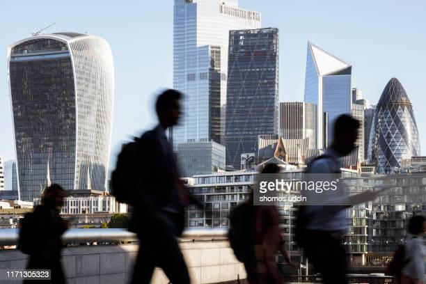 london city workers against high rise office buildings - city stock pictures, royalty-free photos & images