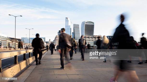 london city workers during rush hour - central london stock-fotos und bilder