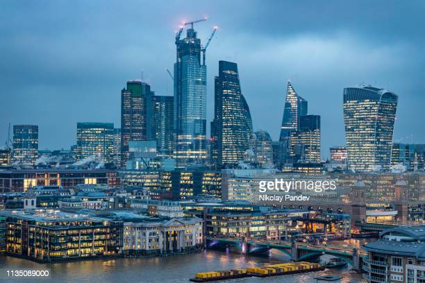 london city's financial district skyline during blue hour - stock image - skyline stock pictures, royalty-free photos & images