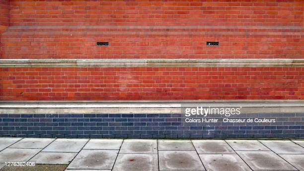 london colored and weathered brick facade with sidewalk - copy space stock pictures, royalty-free photos & images