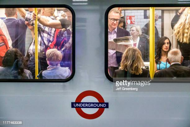 London commuters in crowded subway car