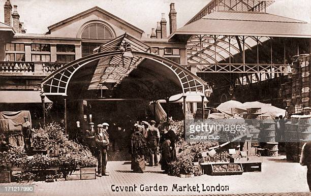 London Covent Garden flower market Porters and flower sellers standing around boxes of flowers In early 1900s