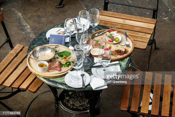London, Covent Garden market, table with empty plates after meal.