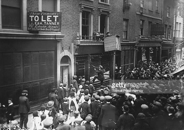 London crowds attack a German business premises in Poplar High Street in the East End of London
