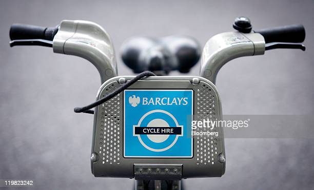 A London Cycle Hire scheme bicycle sponsored by Barclays Plc and the program's operator Serco Plc is seen parked in a docking station on the...