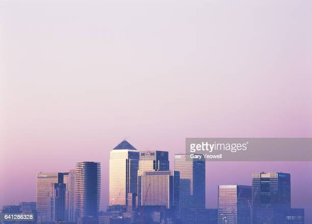 london docklands skyline at sunset - london docklands stock pictures, royalty-free photos & images
