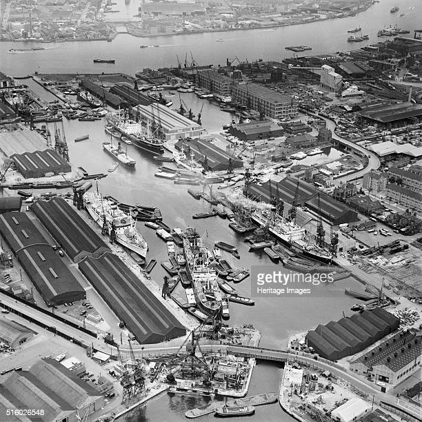 London Docks June 1958 Aerial photograph of Greenland Dock Rotherhithe also showing South Dock the River Thames and the entrance to the Millwall...