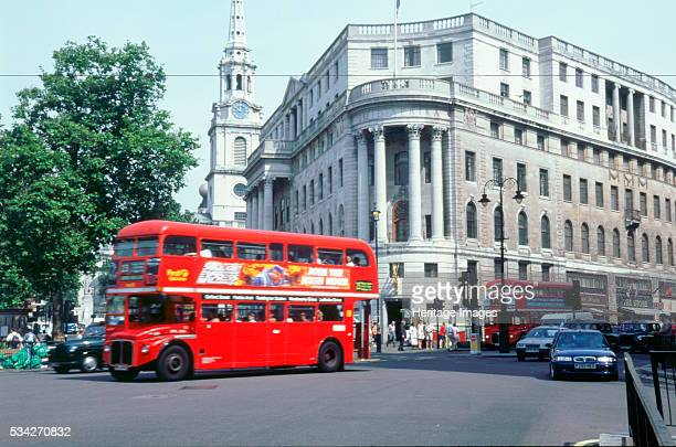 London double decker bus driving through the city, 2000.