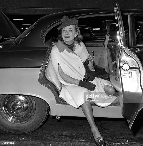 London England 10th September 1971 American film actress Bette Davis gets out from a car at Heathrow airport as she arrives from Scotland where she...