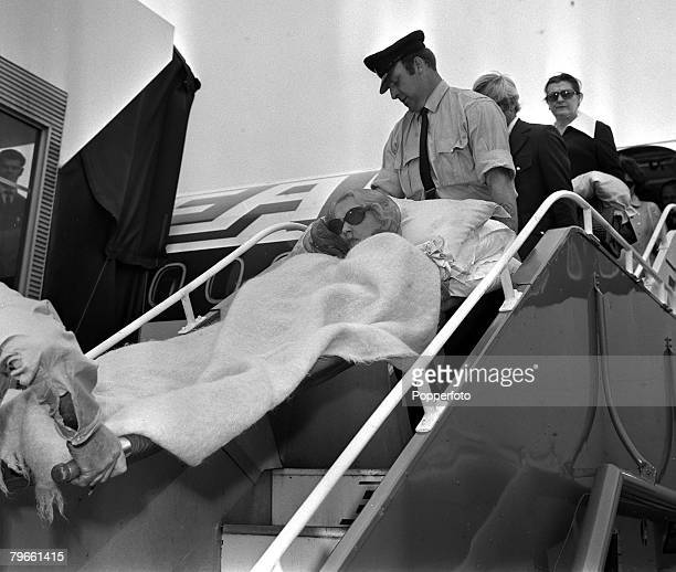 London England 11th June 1971 American Woolworth heiress Barbara Hutton is pictured being stretchered off a plane at Heathrow Mrs Hutton has a...