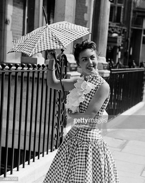 London England 12th August 1955 British film and movie actress Janette Scott pictures holding an umbrella/sunshade