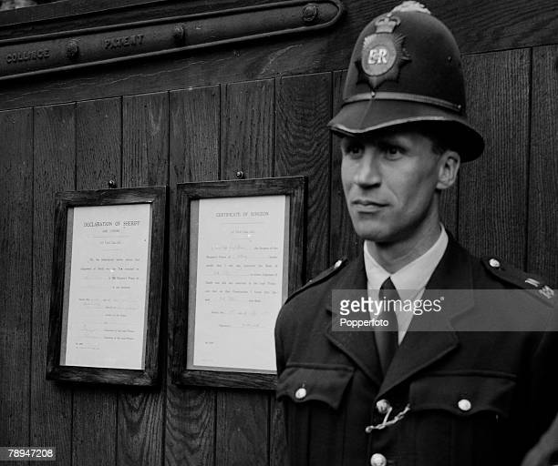 London England 13th July 1955 A policeman infront of Holloway prison with the notice pinned to the wall behind him announcing the hanging of Ruth...