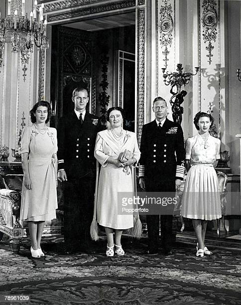 London England 14th October King George VI and Queen Elizabeth stand for a family group with Princess Elizabeth Philip Mountbatten fiance of Princess...