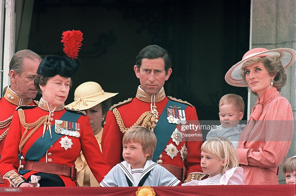 London, England. 15th June 1985. Members of the Royal Family watch the Trooping of the Colour from the balcony of Buckingham Palace during celebrations for the Queen's 'official' birthday. L-R: Prince Phillip (the Duke of Edinburgh), Queen Elizabeth II, P : News Photo
