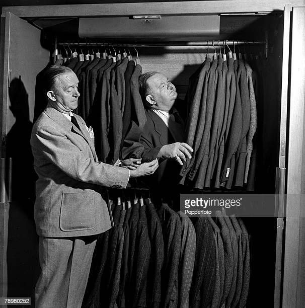 London England 15th March 1947 American comedy duo Stan Laurel and Oliver Hardy pictured at menswear store in London's West End