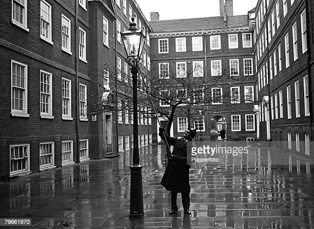 London England 17th February 1972 London's last gas lamp lighter lights a lamp in the Inner Temple during the electricity blackouts caused by the...