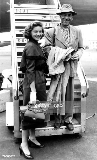 London England 18th July American film actress Humphrey Bogart and his wife Lauren Bacall smiling as they arrive in London following their return...