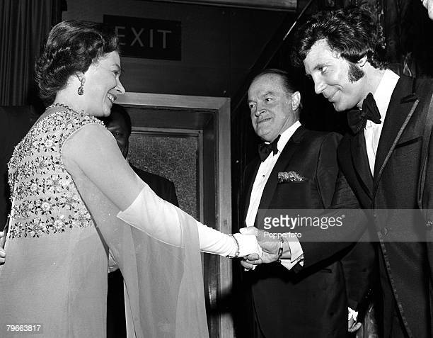 London England 18th November 1970 Her Majesty Queen Elizabeth II shakes hands with Welsh singer Tom Jones watched by US comedian Bob Hope at a...