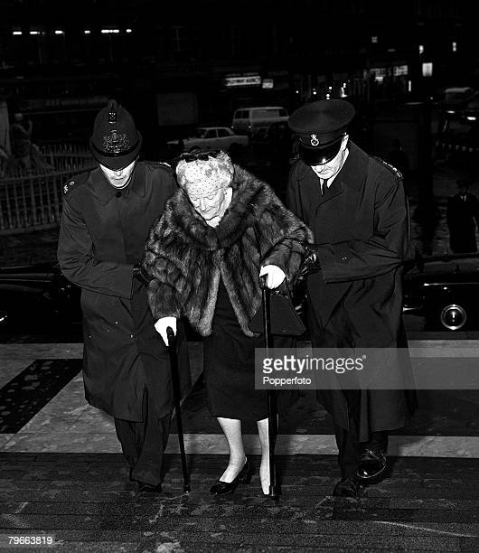 London England 19th November 1970 Baroness Spencer Churchill widow of former British Prime Minister Sir Winston Churchill is helped by two policemen...