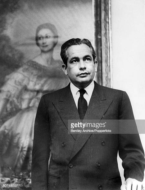 London England 1st December 1960 Portrait of Dr Roberto Arias standing in front of a painting of his wife ballet dancer Dame Margot Fonteyn at the...