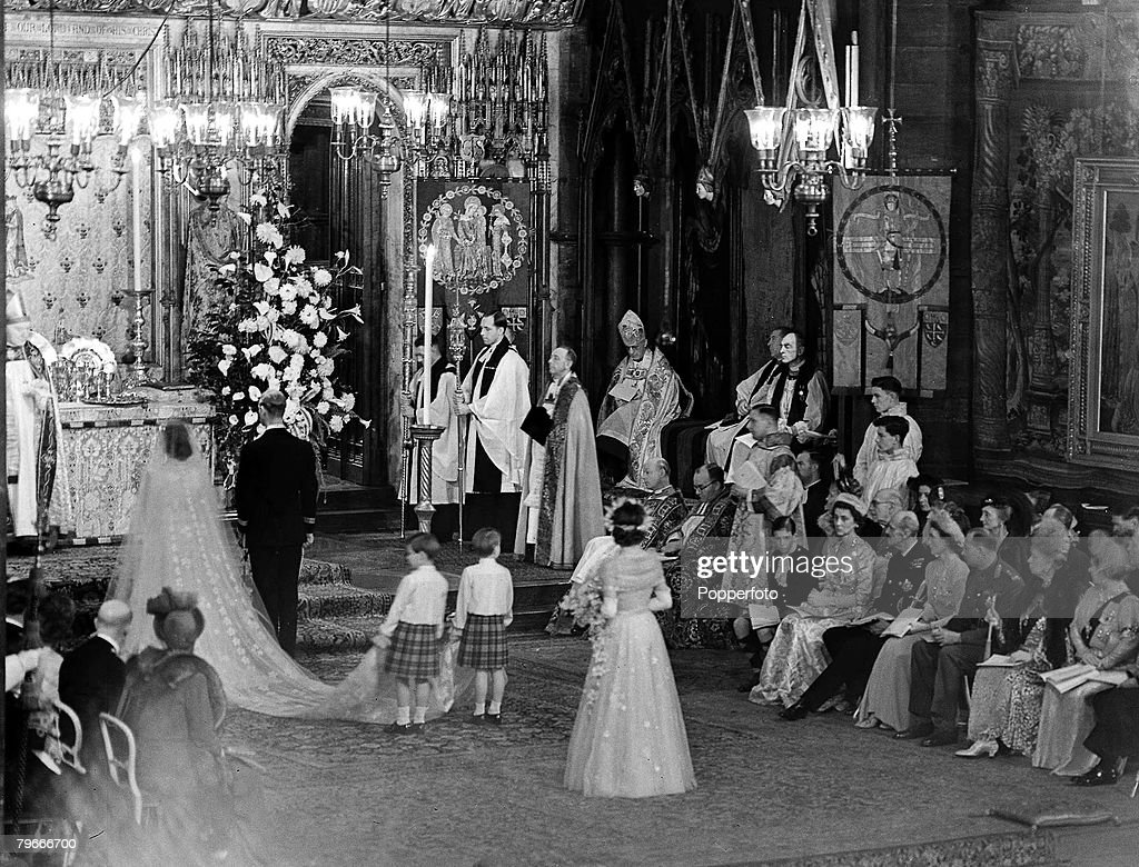London, England, 20th November, 1947, A general view inside Westminster Abbey during the wedding ceremony of Princess Elizabeth (later Queen Elizabeth II) and Philip Mountbatten with the bridesmaids behind them, watched by seated memebers of the Royal Fam : News Photo
