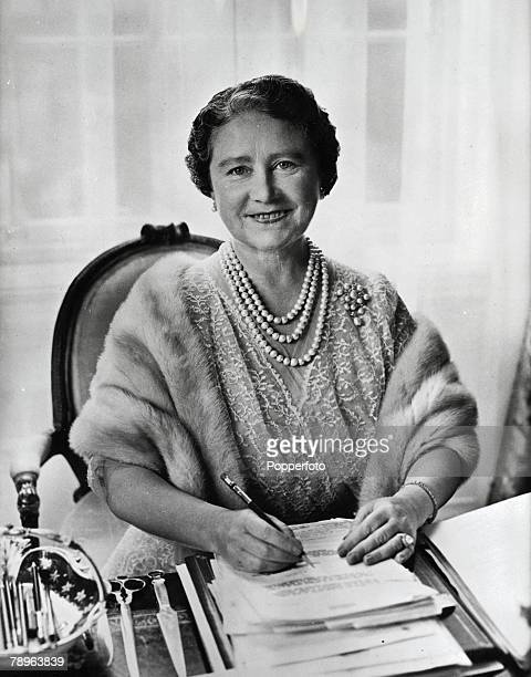 London, England, 23rd July The Queen Mother smiles as she sits at her desk in her private sitting room at Clarence House, London
