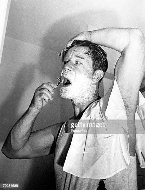 London England 24th August 1949 American comedian and actor Joe E Brown shaves prior to starring in the play Harvey