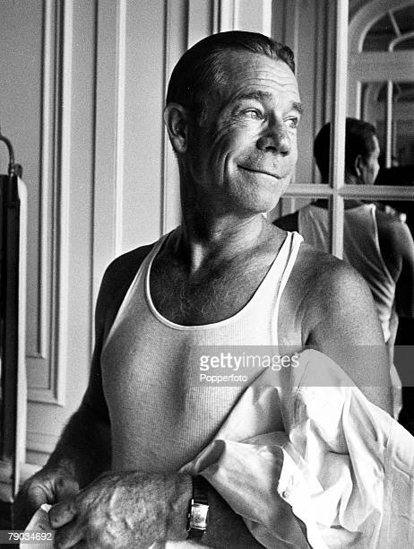 London England 24th August 1949 Candid portrait of American comedian and actor Joe E Brown putting on his shirt prior to starring in the play Harvey