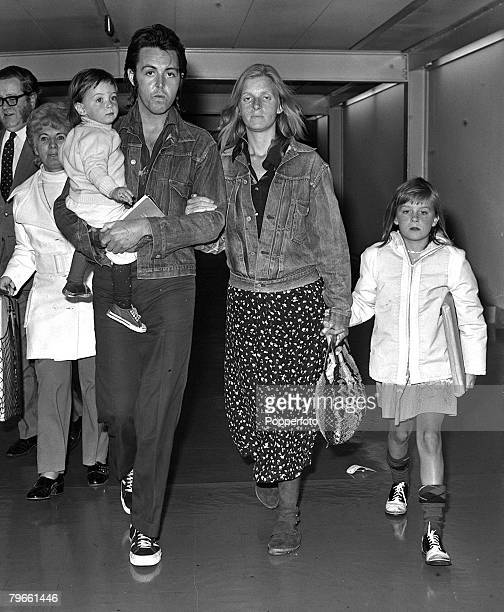 London England 25th March 1971 ExBeatle Paul McCartney is pictured arriving at Heathrow from the USA with his wife Linda 9 year old daughter Heather...