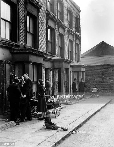 London England 25th March Curious neighbours chatting in Rillington Place in Notting Hill as police guard the entrance to house Number 10 where the...