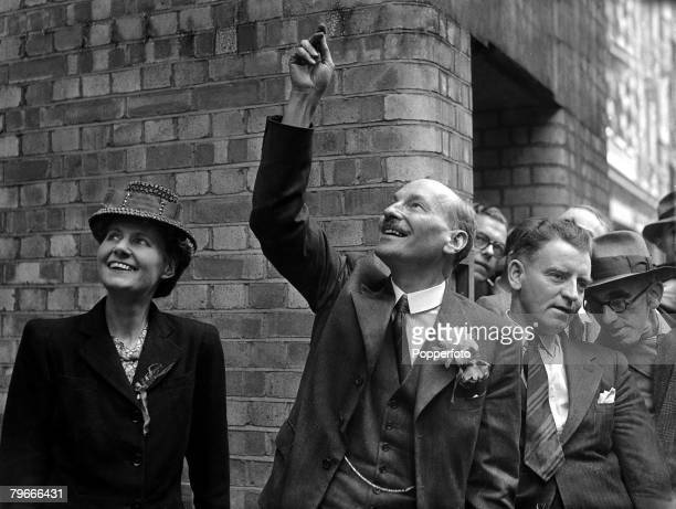 London England 26th July 1945 Labour leader Clement Attlee waves to the crowds at Transport House in Westminster after the surprise socialist victory...