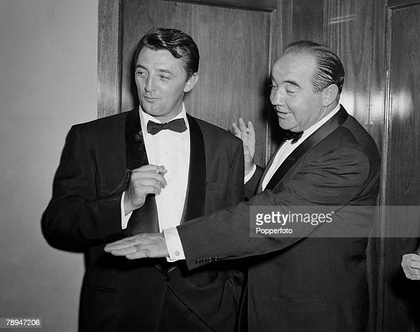 LOndon England 28th July 1955 American film and movie actors Robert Mitchum Broderick Crawford pictured together at a film premier