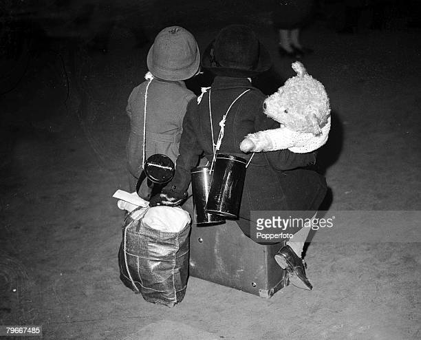 London England 28th October Two little girls and a teddy bear complete with three gas maks and their belongings packed in a bag as they wait for a...