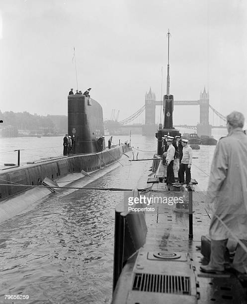 London England 29th July 1960 British Navy submarines HMS Trump HMS Turpin pictured in the London Pool Tower Bridge is in the background