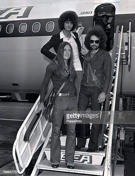 London England 2nd July 1971 Members of American pop group Grand Funk Railroad drummer Don Brewer Mark Farner and Mel Schacher arriving at Heathrow...