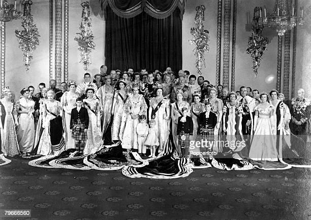 London England 2nd June HRH Queen Elizabeth II wearing her coronation robes and crown stands with other members of the Royal Family and foreign Royal...