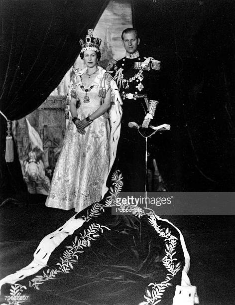 London England 2nd June HRH Queen Elizabeth II wearing the Imperial State Crown and wearing her Coronation dress as she poses with her husband Prince...