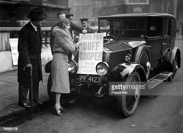 London, England, 3rd March 1931, Lady Duff Cooper attaches a campaign poster to her car in support of her husband's Westminster election campaign...