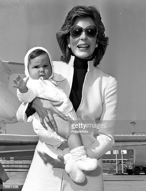 London England 3rd May 1971 The Begum Aga Khan is pictured arriving at Heathrow with her 7 month old daughter Saraha