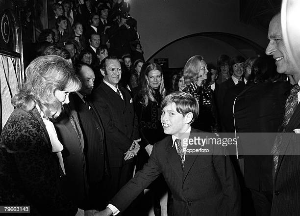 London England 5th January 1972 Prince Andrew shakes hands with British actress Susan Hampshire at the Premier of the film Living Free in London's...