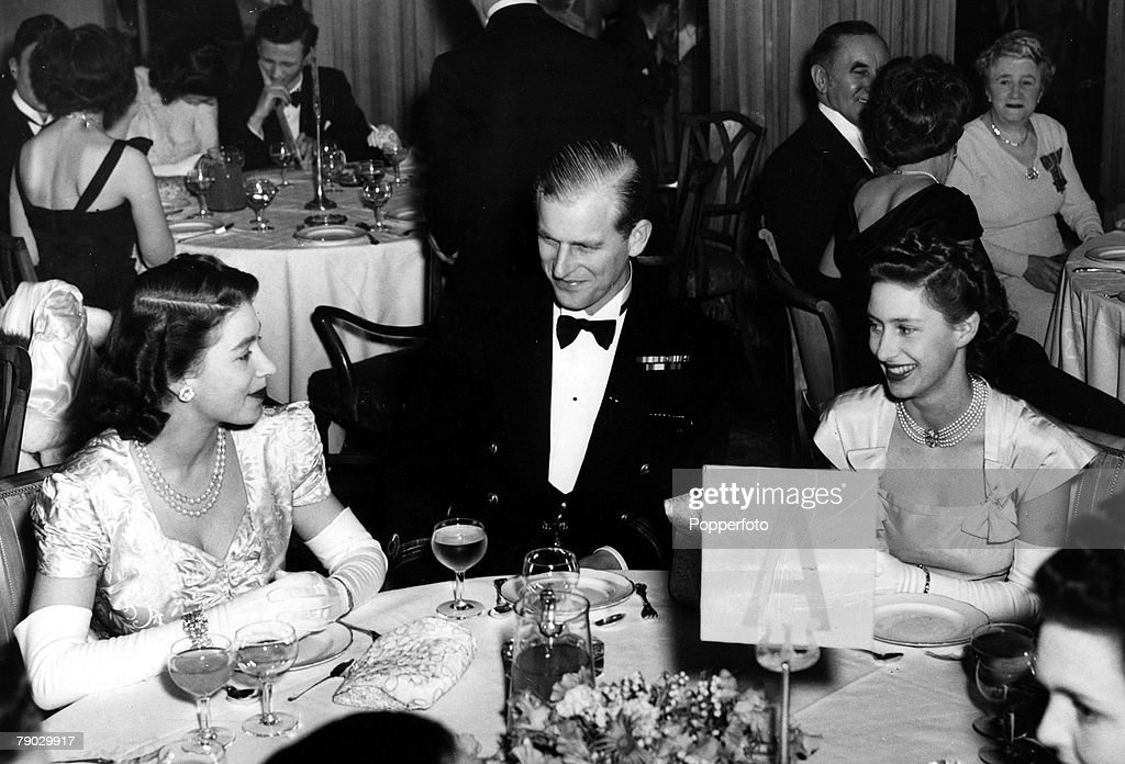 London, England. 5th May 1948. Princess Elizabeth, the Duke of Edinburgh and Princess Margaret sit for supper when they attended the Charity Ball held in aid of King George V Sailor fund at the Dorchester Hotel. : News Photo